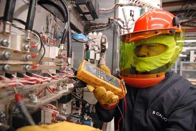 UPS technician performing preventive UPS maintenance