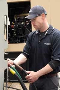EEC tech doing load bank test on data center generator